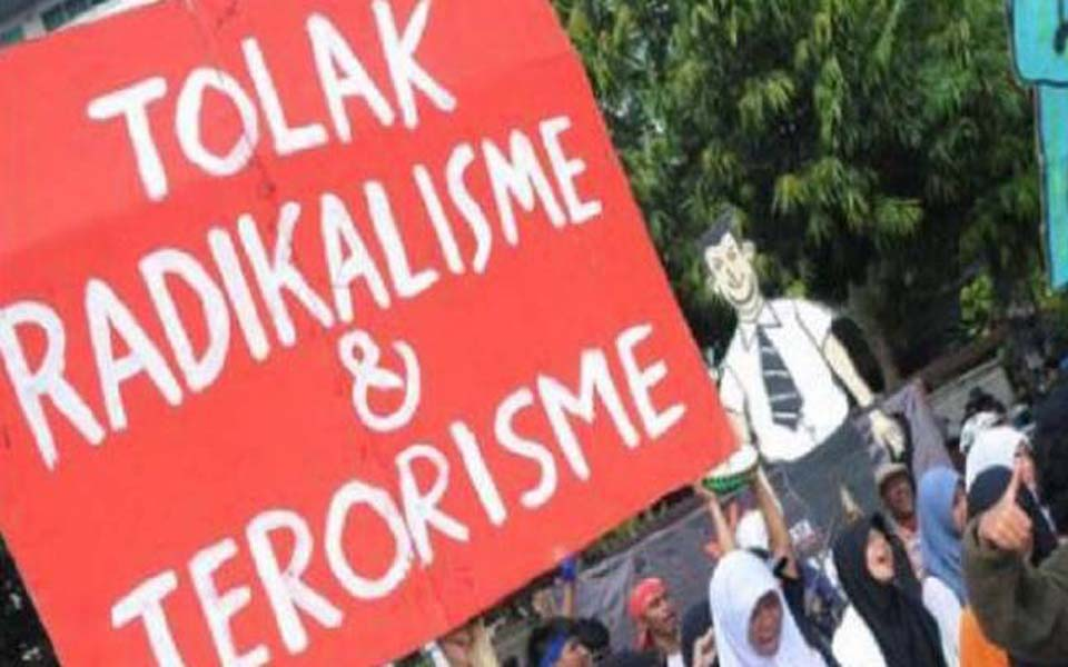 Banner reads 'Reject Radicalism and Terrorism' (KBR)