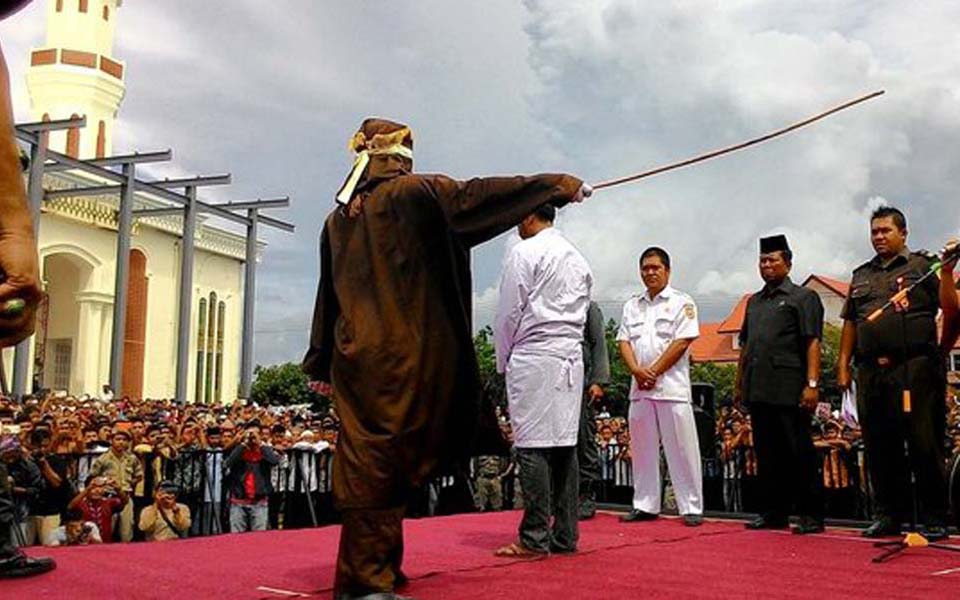 Convicted gamblers being publically flogged in Aceh (Merdeka)