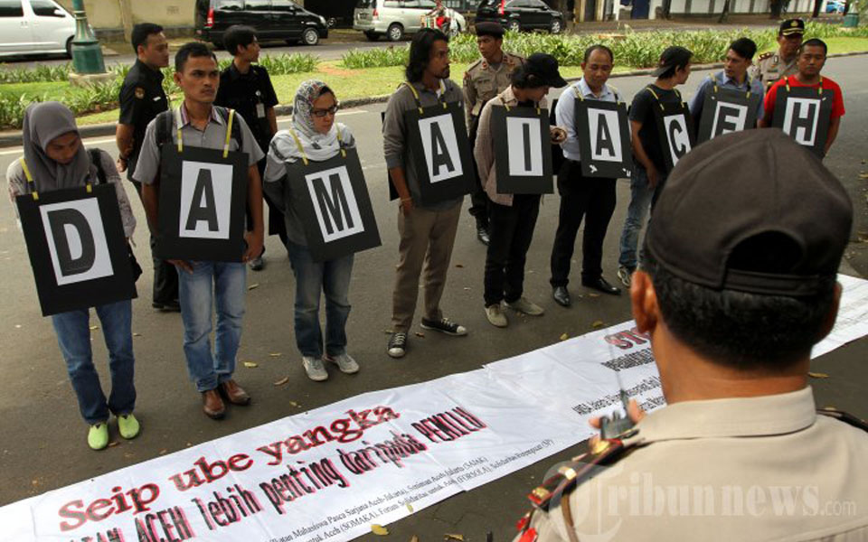 Rights activists protest against election violence in Aceh (Tribune)
