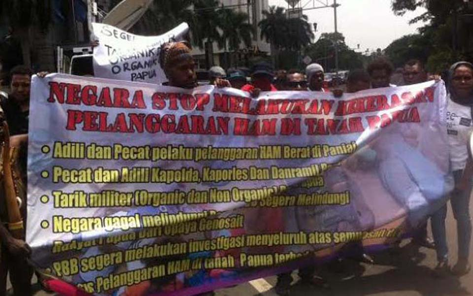 Rally demanding justice for human rights violations in Papua - December 10, 2014 (Liputan6)