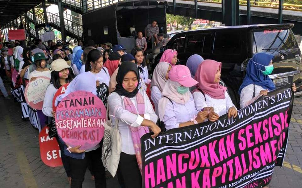 Activists in Makassar mark IWD with calls to end violence against women and children
