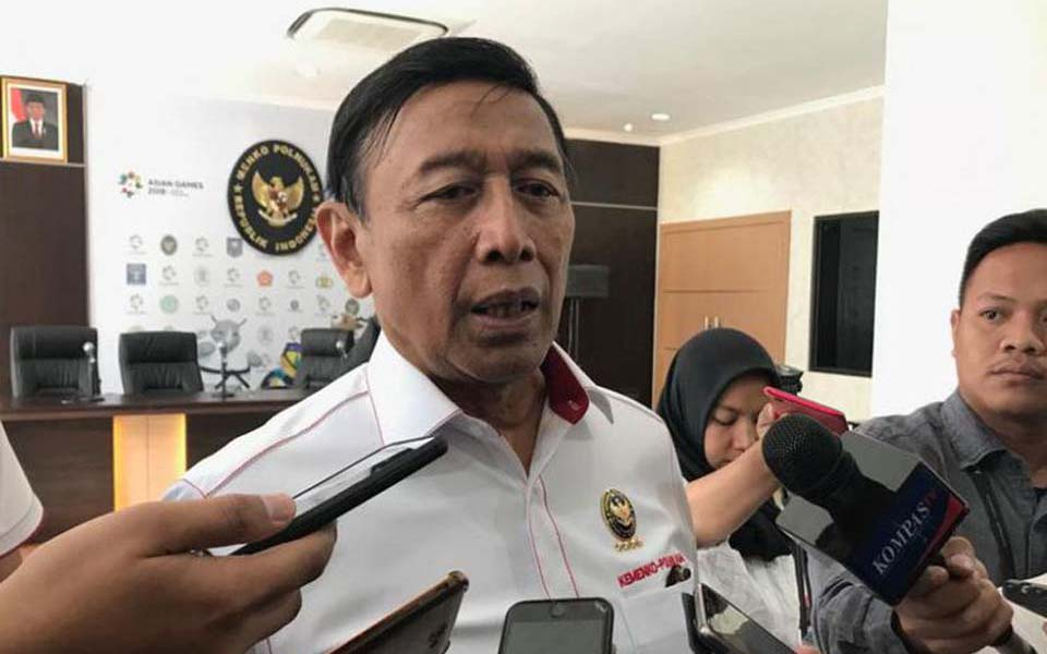 Security minister Wiranto speaks to journalists in Jakarta - August 27, 2018 (Kompas)