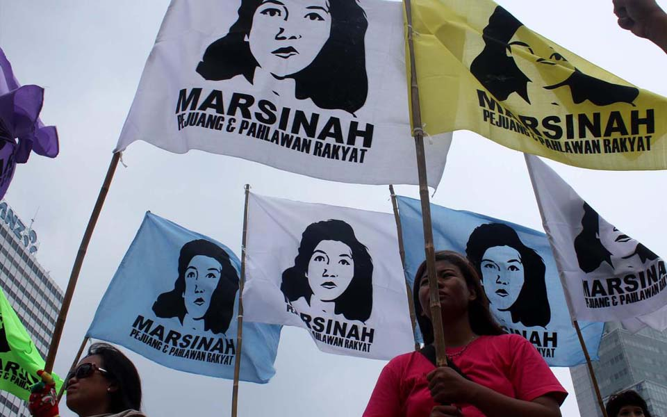 Flags read 'Marsinah – Fighter and Hero of the People (Liputan 6)