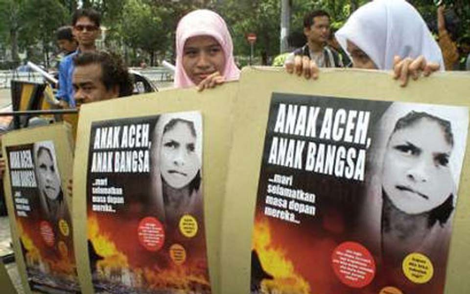 Acehnese pro-independence activists mark human rights day (Reuters)