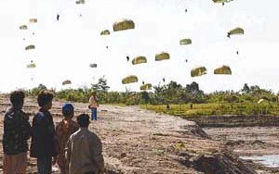 Indonesian troops parachuting into Aceh (Acheh Zone)