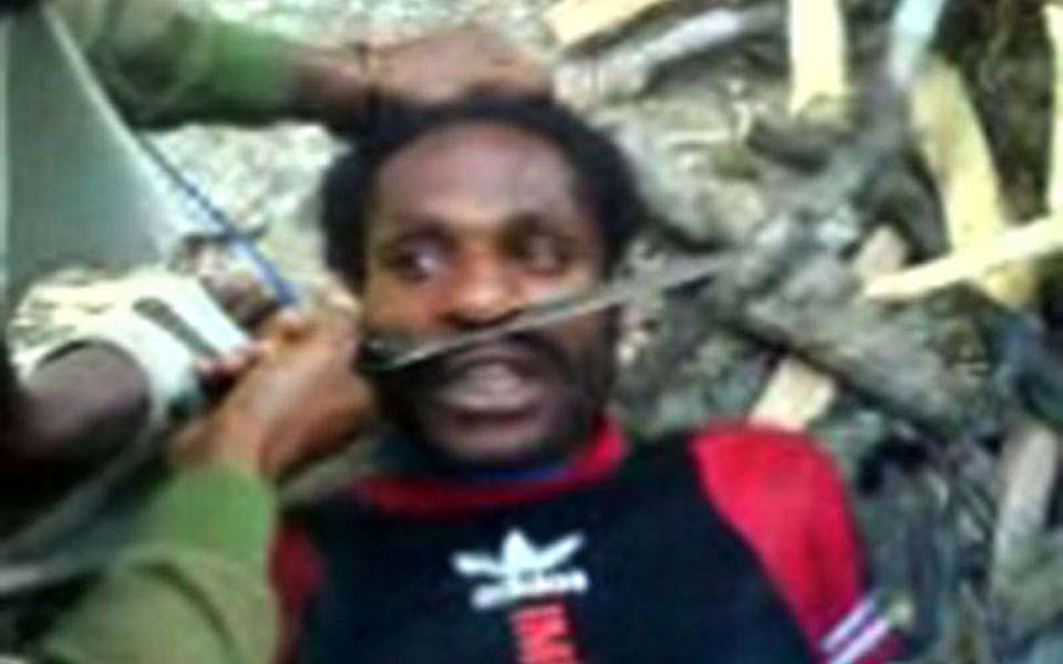 Screen shot from shocking West Papua torture video
