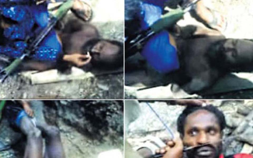 Video posted on YouTube showing two Papuan men being tortured by soldiers
