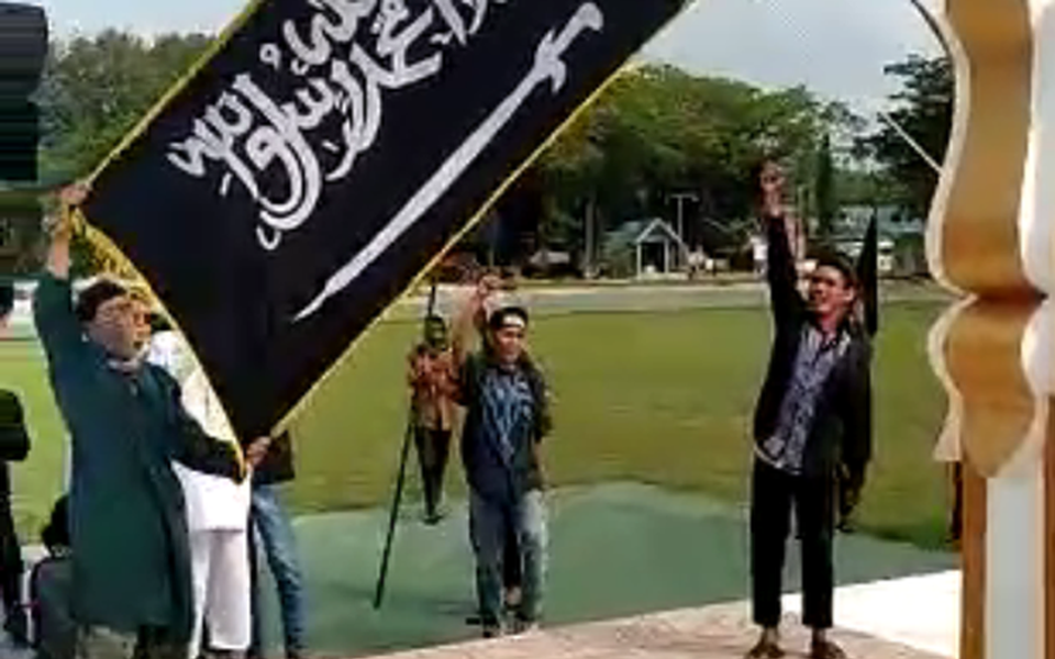 Screenshot from video of HTI flag raising in Poso - October 26, 2018 (Detik)