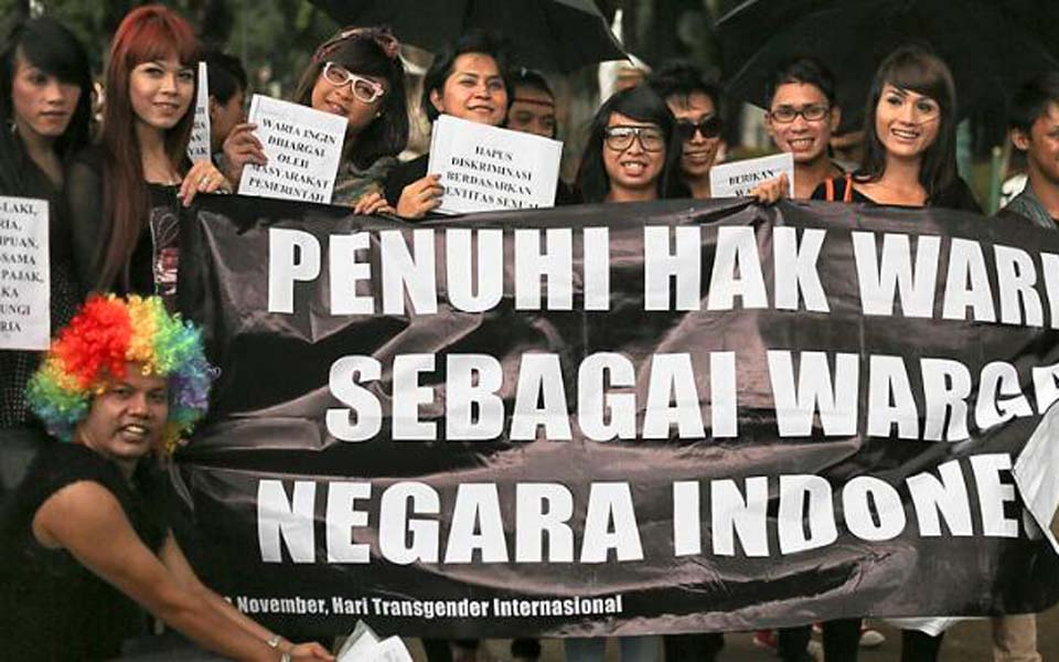Banner reads 'Fulfill the Rights of Trans-Women as Indonesian Citizens' (Caracicak)