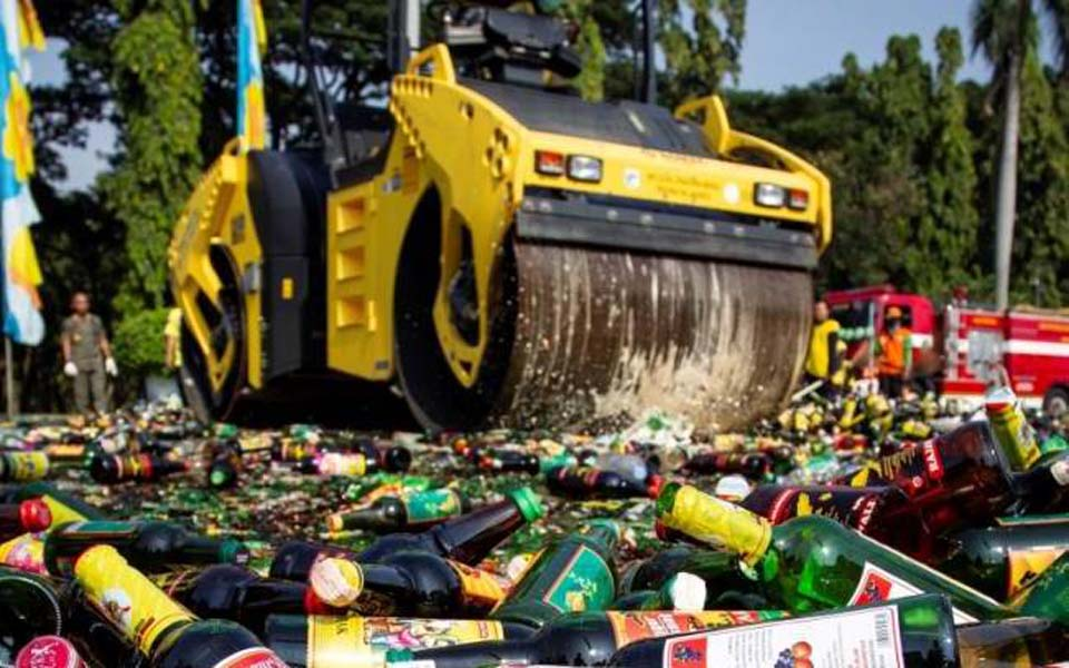 Illegal alcohol being bulldozed at National Monument in Jakarta – May 27, 2019 (Antara)