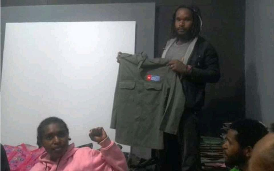 KNPB activist holding shirt with Morning Star logo (Jubi)