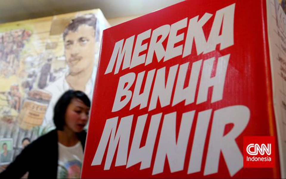 Kontras poster reading 'They Murdered Munir' – November 30, 2014 (CNN)