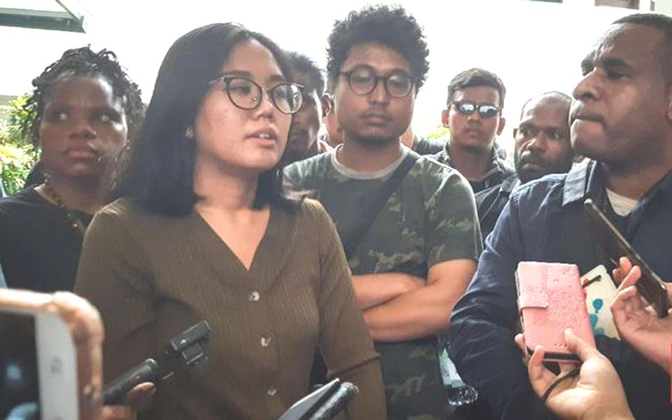Papua Advocacy Team lawyer Okky Wiratama (second left) speaks to reporters (CNN)