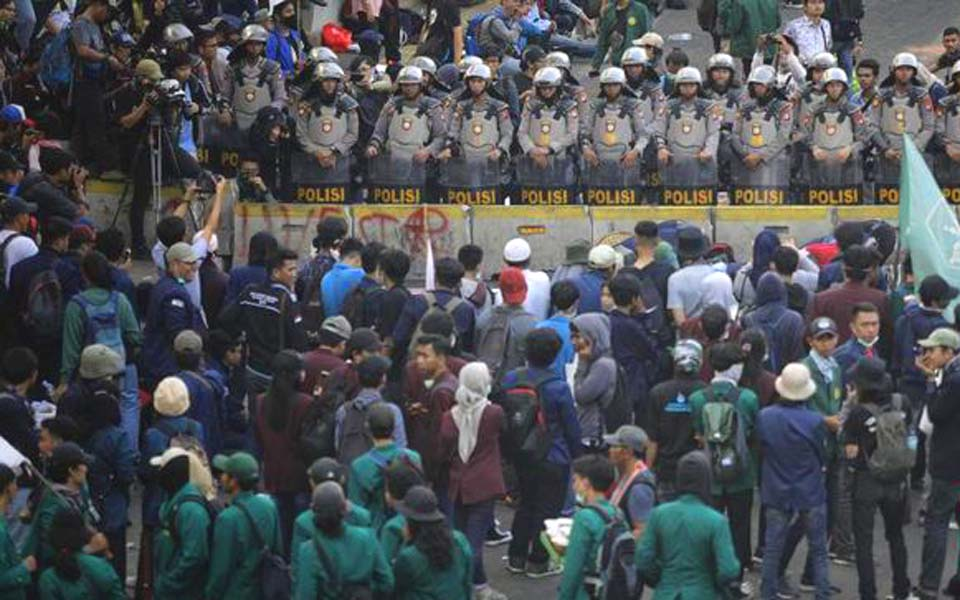 Students and police face off during protest in Jakarta (CNN)