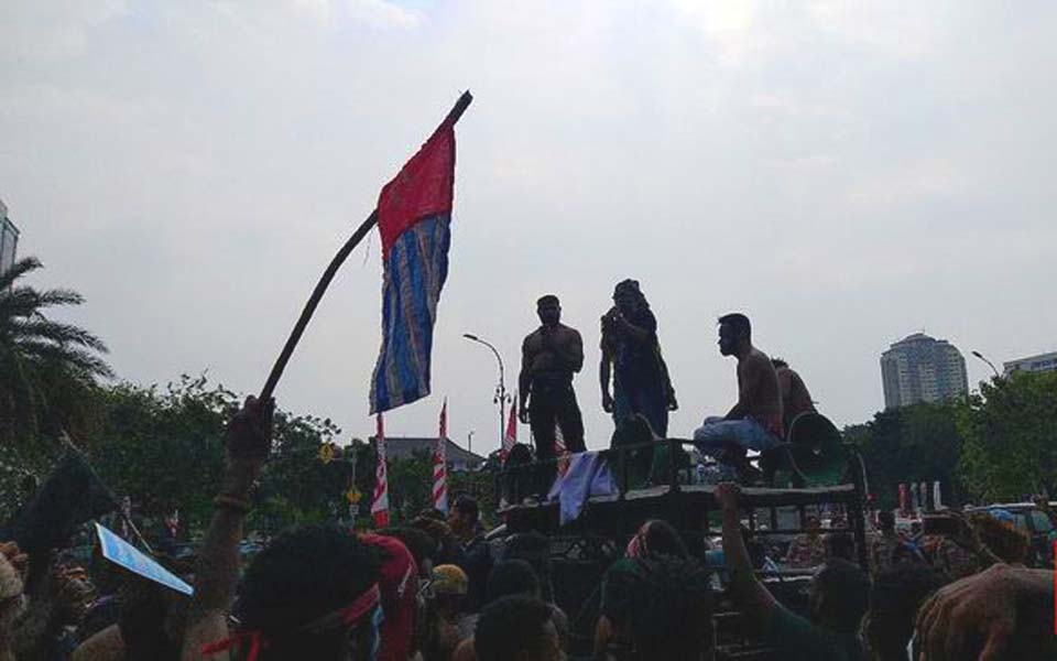 Students fly Morning Star flag at rally in Jakarta – August 22, 2019 (CNN)