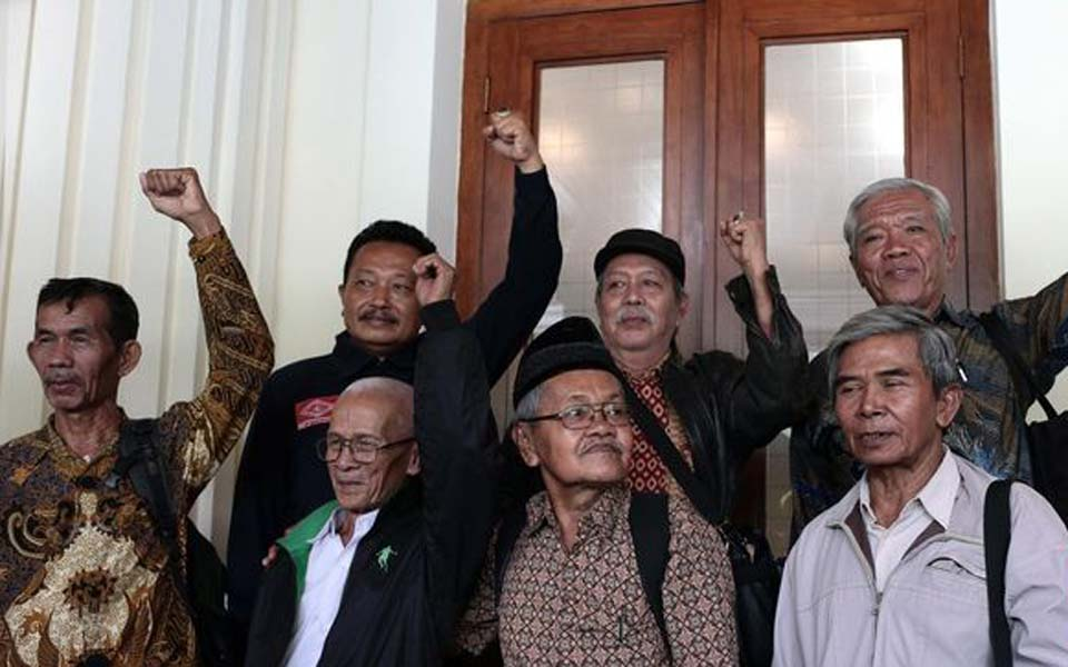YPKP 65 and 1965 survivors at security ministry office in Jakarta (CNN)
